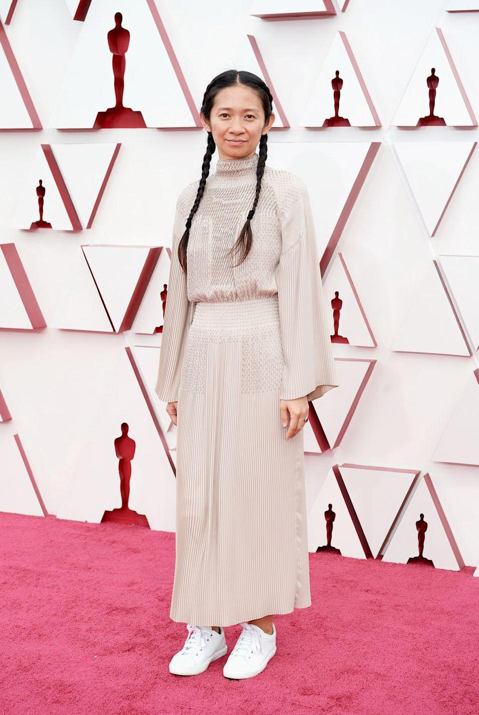 <p>We were so distracted by the Nomadland director's stunning cream-coloured dress that we almost didn't see the fact she styled her look with box-white trainers. Comfortable and chic, what more could you want? </p><p>Later in the evening, the director became the first woman of colour, and the second woman ever, to win the Best Director Oscar. Go, Chloé!</p>