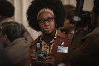 """This image released by Disney shows Kirby Howell-Baptiste in a scene from """"Cruella."""" (Laurie Sparham/Disney via AP)"""