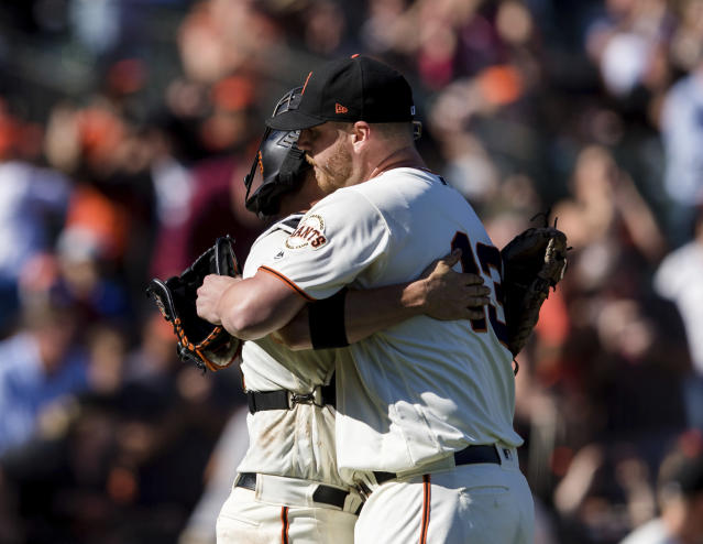 San Francisco Giants closing pitcher Will Smith, right, and catcher Stephen Vogt celebrate after defeating the Miami Marlins in a baseball game in San Francisco, Sunday, Sept. 15, 2019. (AP Photo/John Hefti)