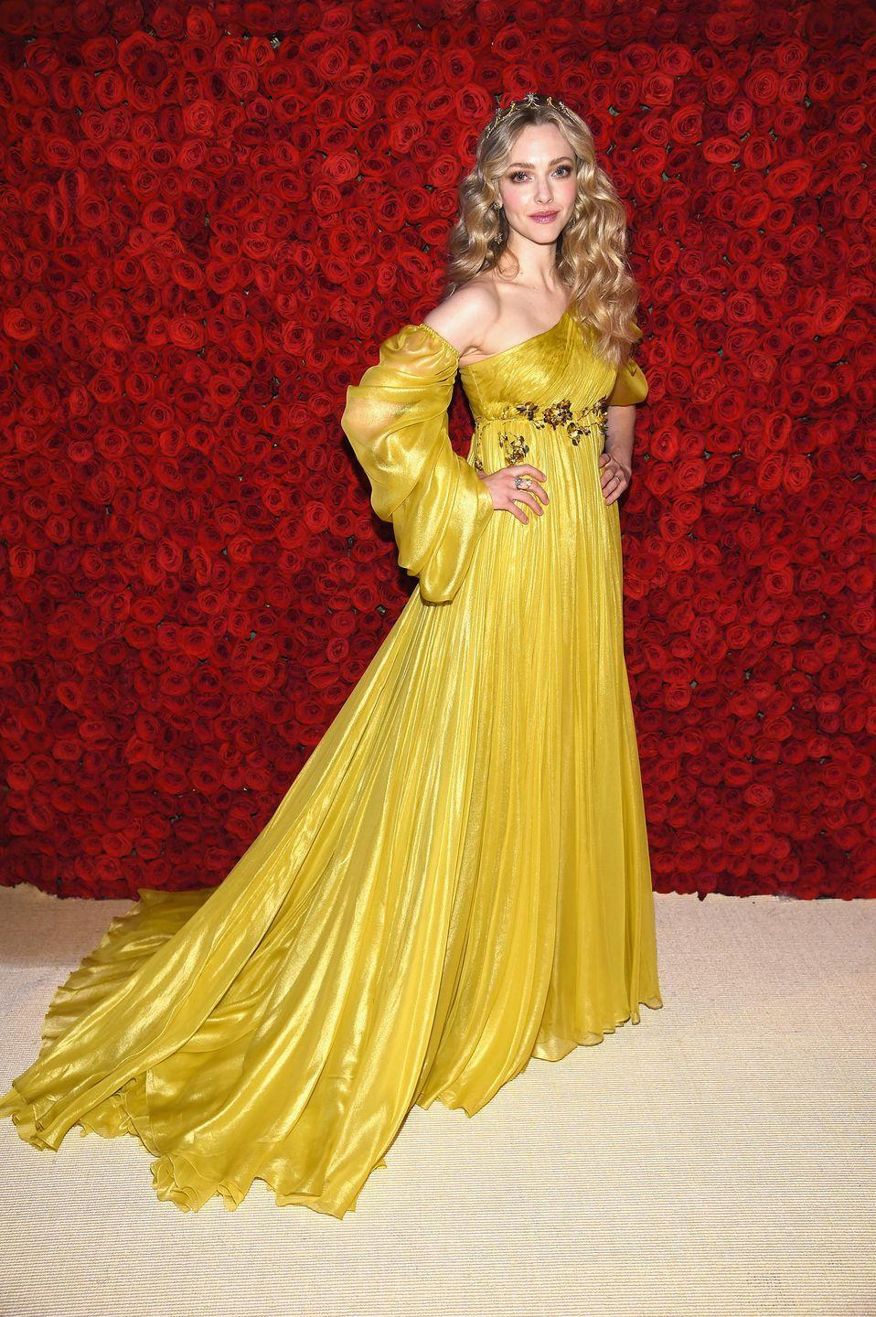 <p>While some thought Amanda Seyfried looked like Shakespeare's Juliet in a yellow Prada gown at the 2018 Met Gala, in front of this wall of red roses, we can only think of Belle from <em>Beauty and the Beast</em>.</p>