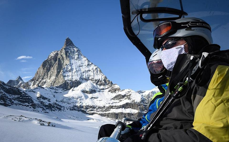 swiss skier in covid mask - fabrice coffrini/getty images