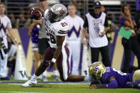 Montana's Isiah Childs (28) carries against Washington in the second half of an NCAA college football game Saturday, Sept. 4, 2021, in Seattle. (AP Photo/Elaine Thompson)