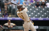 San Diego Padres' Fernando Tatis Jr. connects for a solo home run in the third inning of a baseball game Wednesday, June 16, 2021, in Denver. (AP Photo/David Zalubowski)