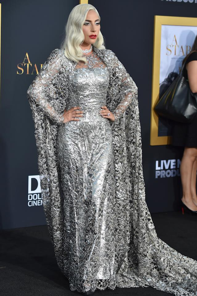 <p>Lady Gaga proved the Hollywood actress life looks good on her at the premiere of 'A Star Is Born', wearing a silver Givenchy Haute Couture gown and cape. [Photo: Getty] </p>