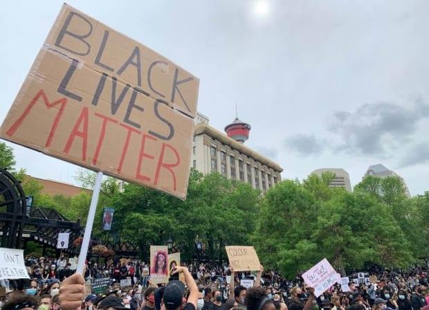 Thousands gathered in Calgary's Olympic Plaza on June 6, 2020 for a candlelight vigil in honour of victims of racism and police brutality.