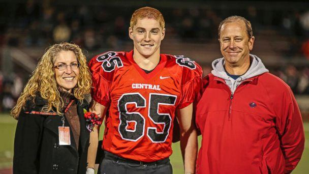 PHOTO: This Oct. 31, 2014 photo shows Timothy Piazza, center, with his parents Evelyn Piazza, left, and James Piazza, right, during Hunterdon Central Regional High School football's 'Senior Night' at the high school's stadium in Flemington, N.J. (Patrick Carns/AP Photo)