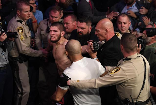 Khabib Nurmagomedov is involved in a postfight incident following his defeat of Conor McGregor in their UFC lightweight championship bout during UFC 229 inside T-Mobile Arena on Oct. 6, 2018 in Las Vegas. (Getty Images)
