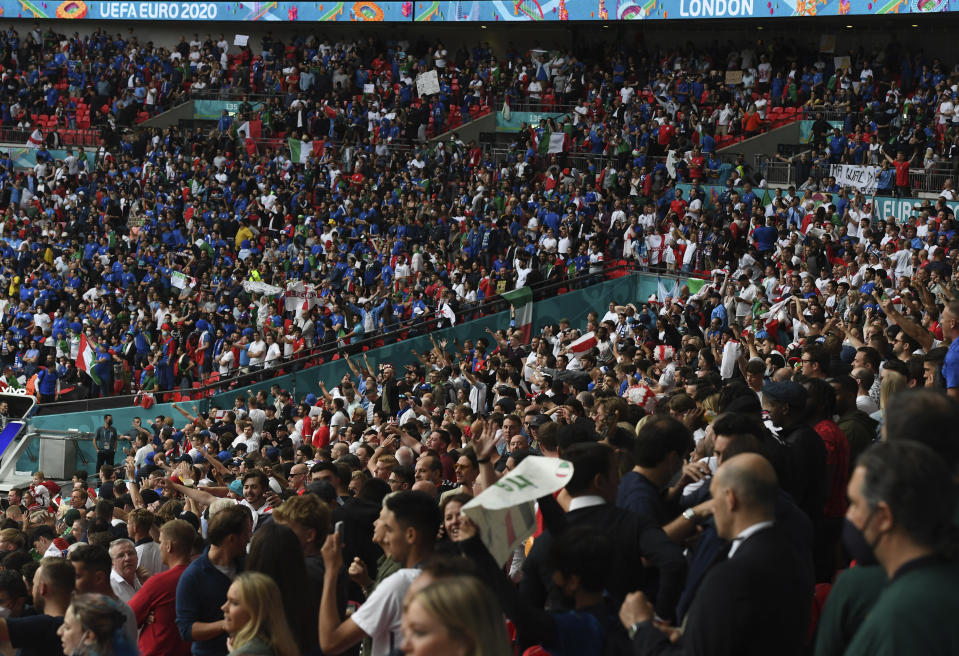Fans cheer prior to the Euro 2020 final soccer match between Italy and England at Wembley stadium in London, Sunday, July 11, 2021. (Facundo Arrizabalaga/Pool via AP)