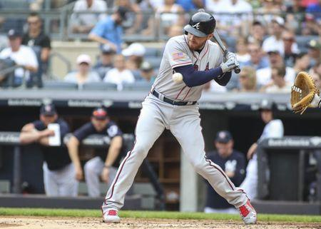 Jul 4, 2018; Bronx, NY, USA; Atlanta Braves first baseman Freddie Freeman (5) is hit by a pitch in the third inning against the New York Yankees at Yankee Stadium. Mandatory Credit: Wendell Cruz-USA TODAY Sports