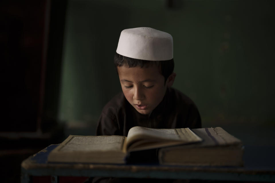 A student reads the Quran, Islam's holy book, at a madrasa in Kabul, Afghanistan, Tuesday, Sept. 28, 2021. (AP Photo/Felipe Dana)