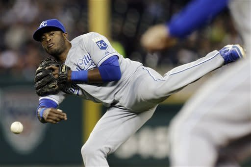 Kansas City Royals second baseman Irving Falu throws to first base for an out on a ground ball from Detroit Tigers' Omar Infante in the second inning of a baseball game in Detroit, Wednesday, Sept. 26, 2012. (AP Photo/Paul Sancya)