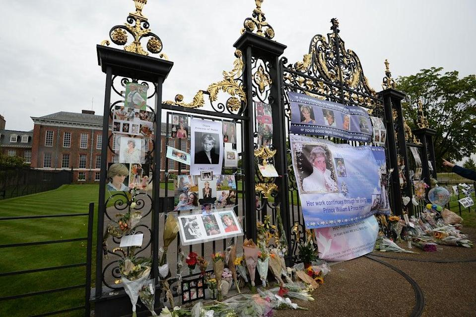 Tributes attached to the Golden Gates of Kensington Palace in 2017 ahead of the 20th anniversary of Diana's death (PA) (PA Archive)