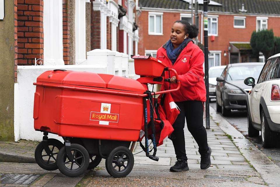 A Royal Mail worker delivering in Balham, Wandsworth in London. Photo: Kirsty O'Connor/PA via Getty