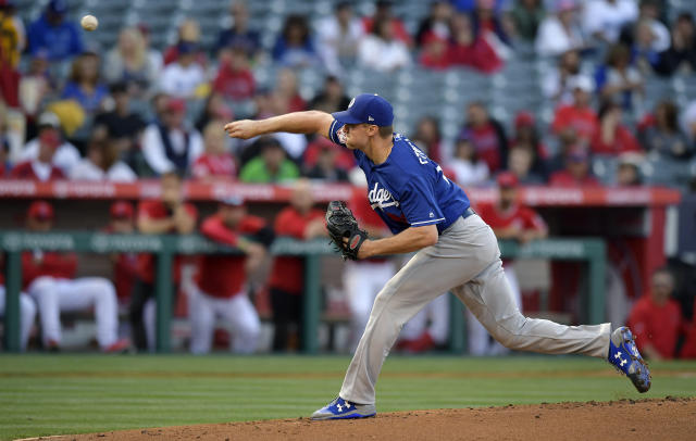 Los Angeles Dodgers starting pitcher Ross Stripling throws to the plate during the first inning of a preseason baseball game against the Los Angeles Angels Sunday, March 24, 2019, in Anaheim, Calif. (AP Photo/Mark J. Terrill)