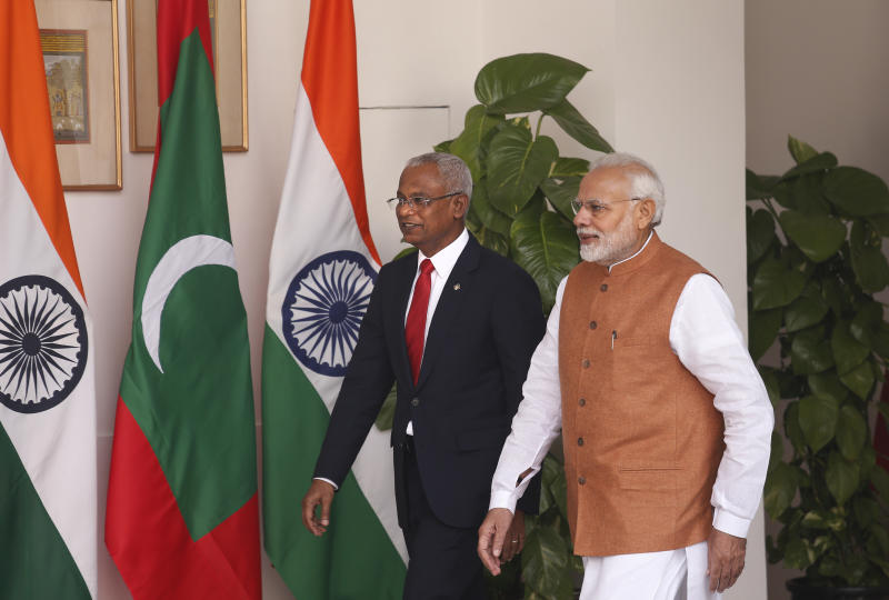 Indian Prime Minister Narendra Modi, right, and Maldives President Ibrahim Mohamed Solih arrive for a meeting in New Delhi, India, Monday, Dec. 17, 2018. Solih is on a three-day visit to India. (AP Photo/Manish Swarup)