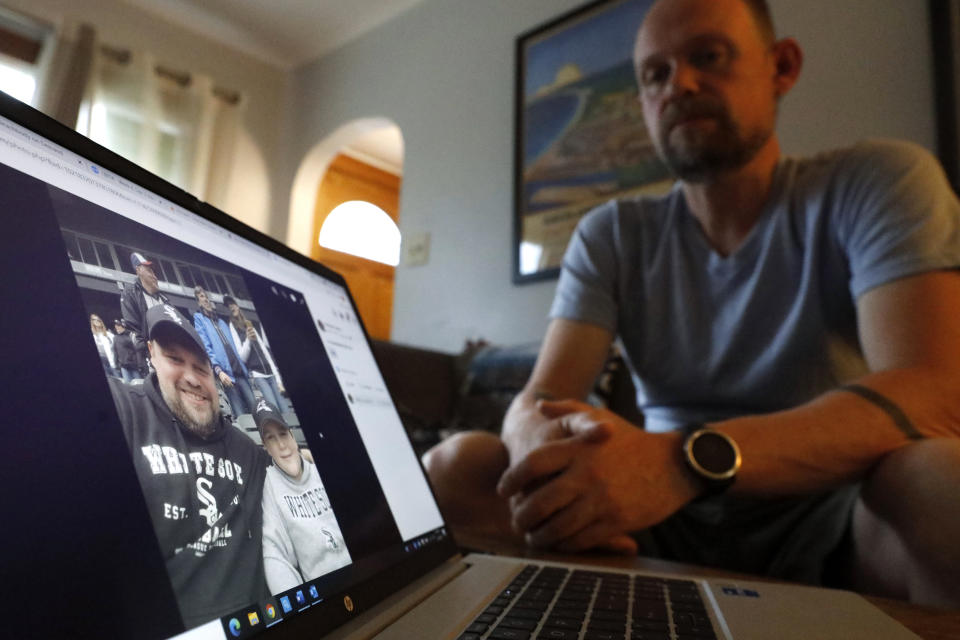 Christian Hainds displays a picture of himself when he was around 230 pounds displayed on a computer screen, Monday, June 7, 2021, in Hammond, Ind. Health officials have warned since early on in the pandemic that obesity and related conditions such as diabetes were risk factors for severe COVID-19. It wasn't until he was diagnosed as diabetic around the start of the pandemic that he felt the urgency to make changes. Hainds lost about 50 pounds during the pandemic, and at 180 pounds and 5 feet, 11 inches tall is no longer considered obese. (AP Photo/Shafkat Anowar)