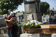 Relatives grieve during the burial service for Monica Cristina, 49, who died from complications related to COVID-19, at the Inahuma cemetery in Rio de Janeiro, Brazil, Wednesday, April 28, 2021. Some 2,400 people have died every day over the past week, triple the amount in the U.S. (AP Photo/Bruna Prado)