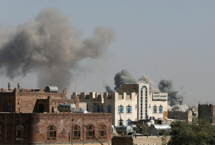 Smoke billows from the sites of Saudi-led air strikes in Sanaa