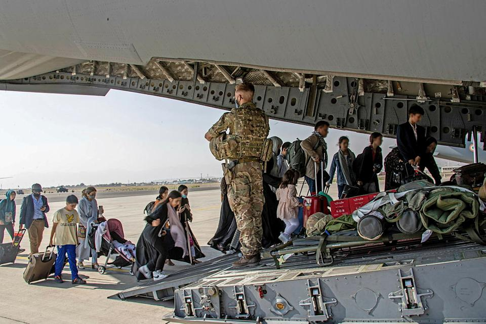 British citizens and dual nationals residing in Afghanistan board a military plane for evacuation from Kabul airport. (Ben Shread/UK MOD Crown copyright 2021/Handout via Reuters)