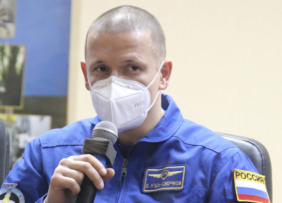 In this handout photo released by Roscosmos, Russian cosmonaut Sergey Kud-Sverchkov, member of the main crew to the International Space Station (ISS), speaks during a news conference at the Baikonur Cosmodrome, Kazakhstan, Tuesday, Oct. 13, 2020. U.S. astronaut Kate Rubins, Russian cosmonauts Sergey Ryzhikov, and Sergey Kud-Sverchkov are the next crew of the Soyuz mission to the International Space Station scheduled on Wednesday, Oct. 14. (Roscosmos Space Agency Press Service via AP)