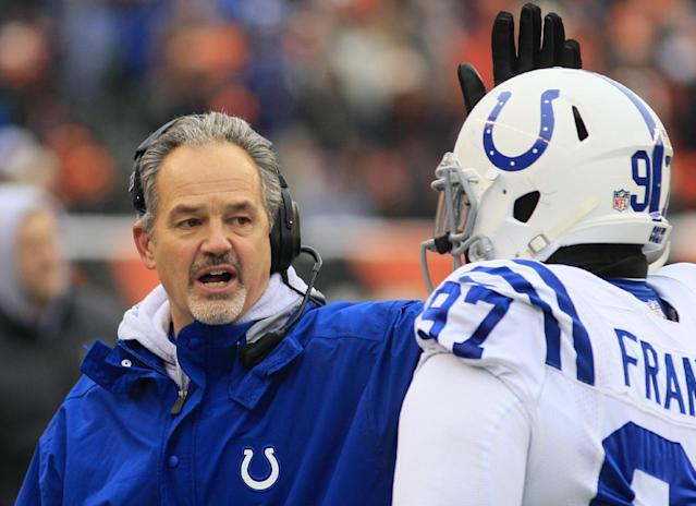 Indianapolis Colts head coach Chuck Pagano pats Aubrayo Franklin (97) on the helmet as he walks off the field in the first half of an NFL football game against the Cincinnati Bengals, Sunday, Dec. 8, 2013, in Cincinnati. (AP Photo/Tom Uhlman)