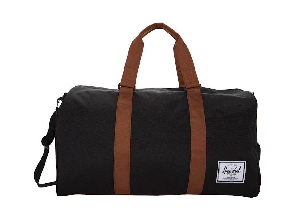 """<p><strong>Herschel Supply Co.</strong></p><p>zappos.com</p><p><strong>$99.94</strong></p><p><a href=""""https://go.redirectingat.com?id=74968X1596630&url=https%3A%2F%2Fwww.zappos.com%2Fp%2Fherschel-supply-co-novel%2Fproduct%2F9475833&sref=https%3A%2F%2Fwww.thepioneerwoman.com%2Fholidays-celebrations%2Fgifts%2Fg36355369%2Fgifts-for-dad-from-son%2F"""" rel=""""nofollow noopener"""" target=""""_blank"""" data-ylk=""""slk:Shop Now"""" class=""""link rapid-noclick-resp"""">Shop Now</a></p><p>Sturdy and nice to look at, this bag is an excellent option for dads who are frequently on the go. Think work trips, beach vacations, and drives to the lake.</p>"""