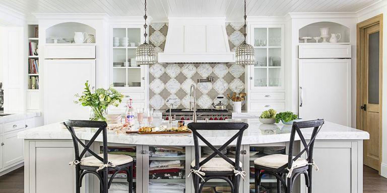 "<p>This airy <a href=""https://www.goodhousekeeping.com/home/decorating-ideas/g2423/beach-house-style/"" rel=""nofollow noopener"" target=""_blank"" data-ylk=""slk:beach house"" class=""link rapid-noclick-resp"">beach house</a> kitchen benefits from graphic backsplash tiles, archway cutouts, and pretty pottery.</p>"