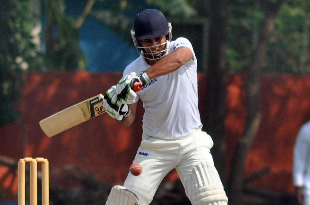 Uttar Pradesh batsman Parvinder Singh in action as he scored 100 during day three of practice match between West Indies and Uttar Pradesh Cricket Association XI at the Jadavpur University Ground in Kolkata on Nov 2, 2013. (Photo: IANS)