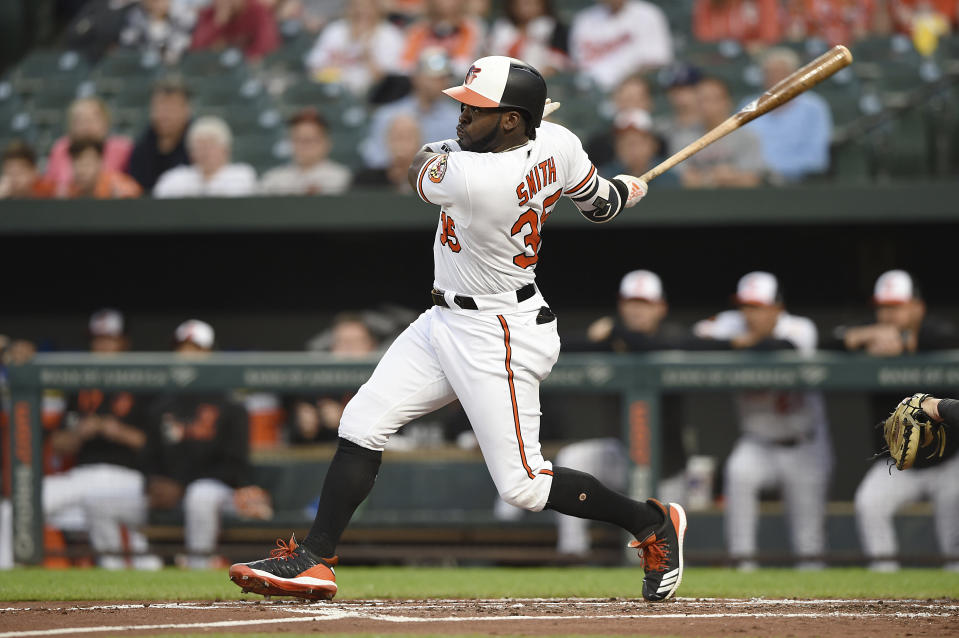 Baltimore Orioles' Dwight Smith Jr. follows through on a double against the Chicago White Sox in the first inning of a baseball game, Wednesday, April 24, 2019, in Baltimore. (AP Photo/Gail Burton)