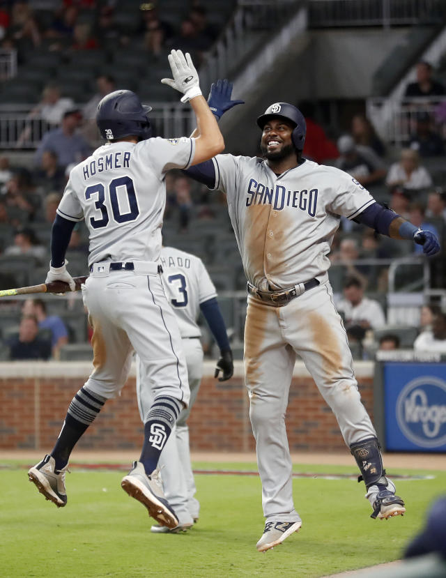 San Diego Padres' Franmil Reyes (32) celebrates his second home run of the game with teammate Eric Hosmer (30) in the sixth inning of a baseball game against the Atlanta Braves Tuesday, April 30, 2019, in Atlanta. (AP Photo/John Bazemore)