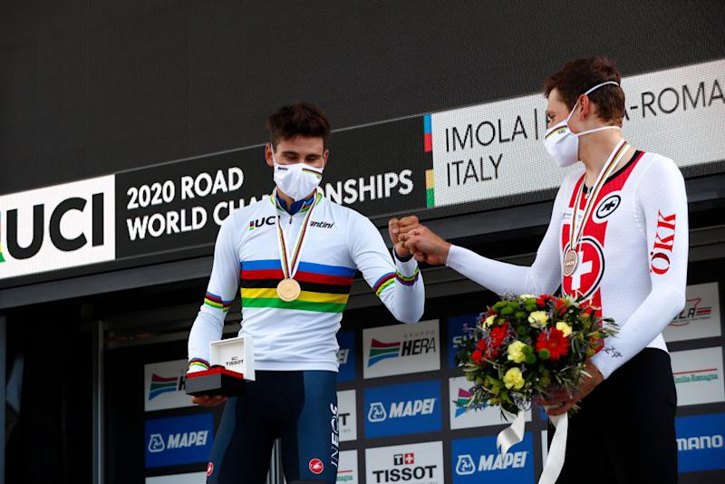 IMOLA ITALY SEPTEMBER 25 Podium Filippo Ganna of Italy Gold medal World Champion Jersey Stefan Kung of Switzerland Bronze medal Celebration Mask Covid Safety Measures Social distancing during the 93rd UCI Road World Championships 2020 Men Elite Individual Time Trial a 317km race from Imola to Imola Autodromo Enzo e Dino Ferrari ITT ImolaEr2020 Imola2020 on September 25 2020 in Imola Italy Photo by Bas CzerwinskiGetty Images