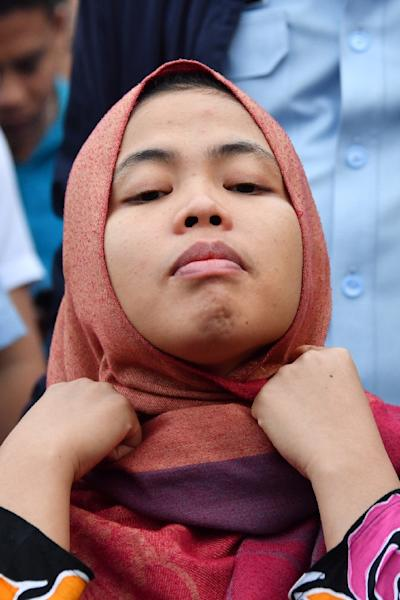Indonesian Siti Aisyah adjusts hear headscarf during a press conference on her return to Indonesia (AFP Photo/ADEK BERRY)