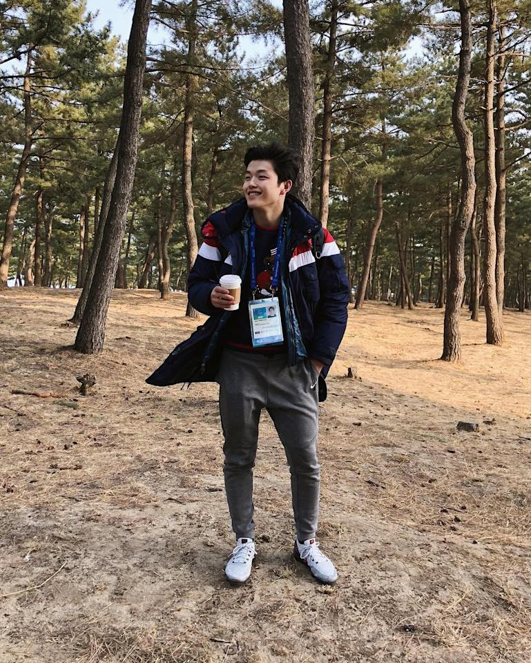 """<p>Took a walk in the """"Coffee Forest"""" today.*It's not actually called the Coffee Forest. I just thought the trees looked cool so I asked @maiashibutani to take a picture of me holding my coffee* (Photo via Instagram/alexshibutani) </p>"""