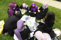 <p>Students make ribbons at a vigil outside the London Muslim Mosque for the victims of the deadly vehicle attack on five members of the Canadian Muslim community in London, Ont., on Tuesday, June 8, 2021. Four of the members of the family died and one is in critical condition. Police have charged a London man with four counts of murder and one count of attempted murder. THE CANADIAN PRESS/Nathan Denette</p>