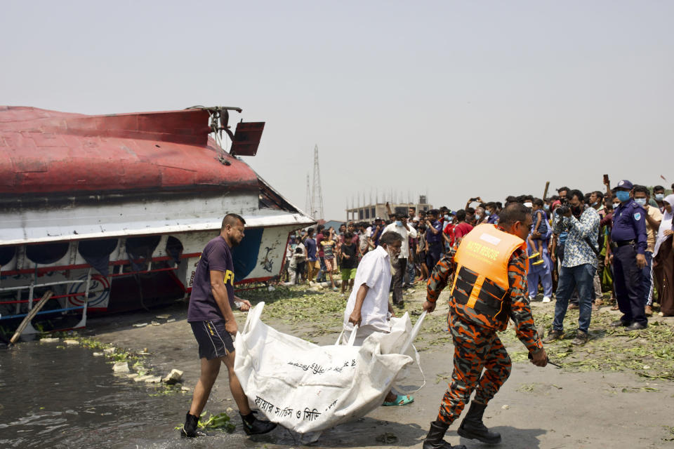 Rescuers recover bodies after a ferry sank Sunday night after being hit by a cargo vessel in the Shitalakkhya River in Narayanganj district, outside Dhaka, Bangladesh, Monday, April 5, 2021. (AP Photo/Mushfiqul Alam)