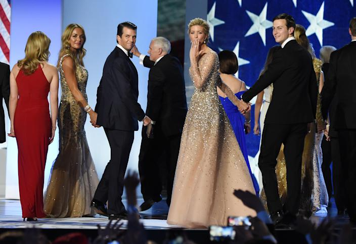 Ivanka Trump (C) blows a kiss to the crowd as she leaves the stage with her husband Jared Kushner (R) and her brother Donald Trump Jr and his wife Vanessa Trump, after dancing on stage during the Freedom ball at the Walter E. Washington Convention Center on January 20, 2017 in Washington, DC. (Photo credit should read ROBYN BECK/AFP via Getty Images)