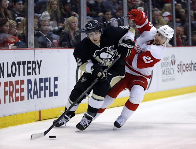 FILE - In this March 20, 2014, file photo, Detroit Red Wings' Tomas Tatar (21), of Slovakia, tries to get to the puck controlled by Pittsburgh Penguins' Matt Niskanen during the second period of an NHL hockey game in Detroit. Washington Capitals general manager Brian MacLellan signed Pittsburgh Penguins free agents Niskanen and Brooks Orpik on Tuesday, July 1, 2014, to deals totaling more than $65 million. (AP Photo/Duane Burleson, File)