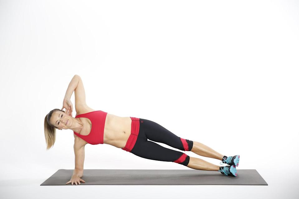 <ul> <li>Come into an elbow plank position and roll to your right side, allowing your feet to roll, too, so you're balancing on the outside of your right foot, stacking your left foot on your right.</li> <li>Place your left hand gently behind your head. Press your left inner thigh up into your right inner thigh; this helps stabilize you even more.</li> </ul>