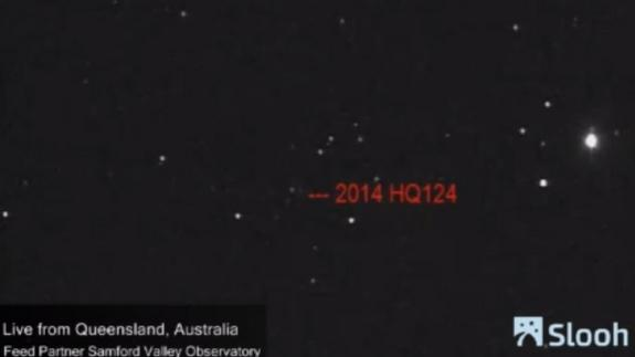 The near-Earth asteroid 2014 HQ124 is seen via telescope from Australia in this June 5, 2014 photo captured by the online Slooh community observatory. The asteroid will fly by Earth, outside the orbit of the moon, on June 8.