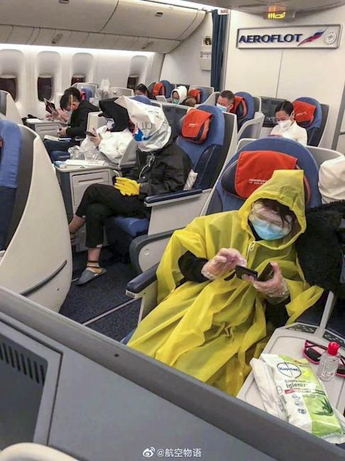 Passengers on a flight from London bound for Hong Kong via Moscow take no chances. Photo: Weibo