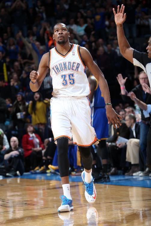 OKLAHOMA CITY, OK - JANUARY 17: Kevin Durant #35 of the Oklahoma City Thunder gestures after hitting a 3-point shot during an NBA game on January 17, 2014 at the Chesapeake Energy Arena in Oklahoma City, Oklahoma. Durant had a career high of 54 points as the Thunder won 127-121. (Photo by Layne Murdoch/NBAE via Getty Images)