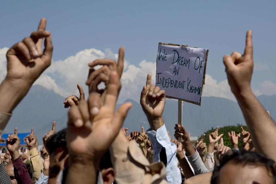 CORRECTS AGE - FILE - In this Friday, Aug. 23, 2019, file photo, Kashmiris shout freedom slogans during a protest against New Delhi's tightened grip on the disputed region, after Friday prayers on the outskirts of Srinagar, Indian controlled Kashmir. The death of top separatist leader Syed Ali Geelani on Sept. 1, 2021, in disputed Kashmir and the ensuing crackdown on public movement and communications by Indian authorities have highlighted the turmoil seething just below the surface in the region. Soon after the 91-year-old's death late Wednesday, authorities quickly clamped down, blocking internet and mobile phone services and restricting public movement out of fear of anti-India protests. (AP Photo/ Dar Yasin, File)