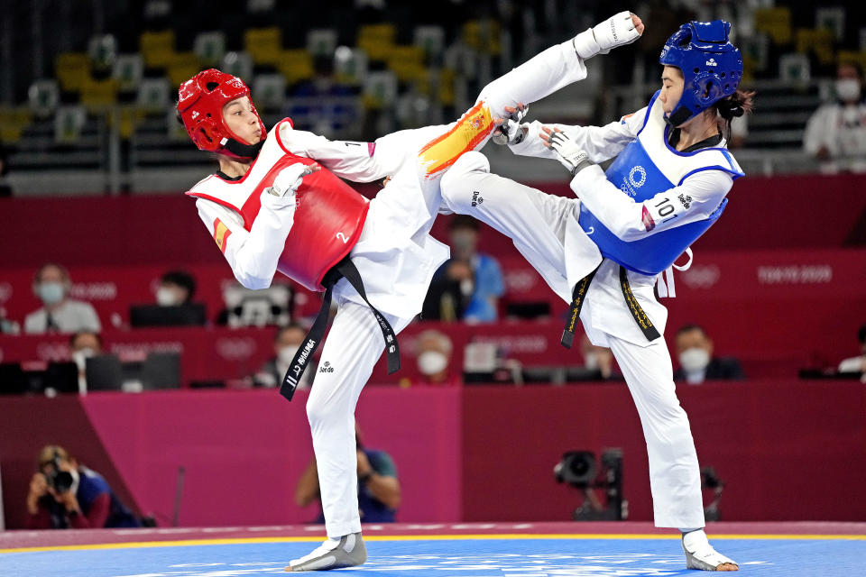 Jul 24, 2021; Chiba, Japan; Panipak Wongpattanakit (THA) fights Adriana Cerezo Iglesias (ESP) in the in the women's -49 gold medal match during the Tokyo 2020 Olympic Summer Games at Makuhari Messe Hall A. Mandatory Credit: James Lang-USA TODAY Network