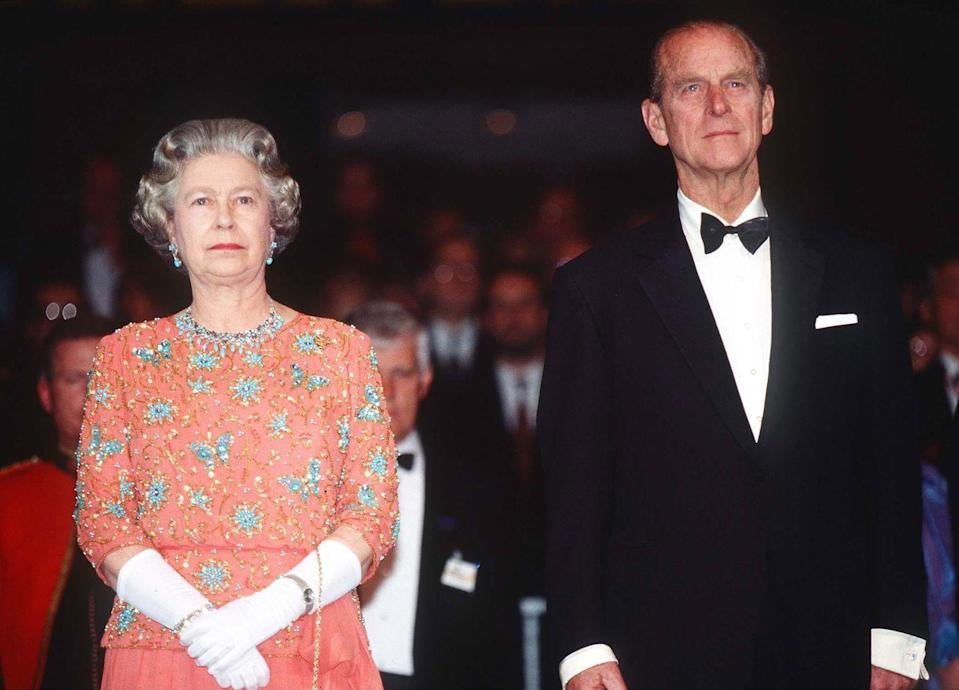 """<p>Elizabeth once called 1992 her annus horribilis — and it was: Three of her four children got divorced or separated. England had a financial recession. On an October state visit to Germany (pictured here), demonstrators threw eggs at her. To top it off, that November, Windsor Castle had a damaging fire. Through it all, she leaned on the man <a href=""""http://www.mirror.co.uk/news/uk-news/prince-philip-quotes-the-queen-and-her-husband-1446365"""" rel=""""nofollow noopener"""" target=""""_blank"""" data-ylk=""""slk:she called"""" class=""""link rapid-noclick-resp"""">she called</a> her """"constant strength and guide.""""</p>"""