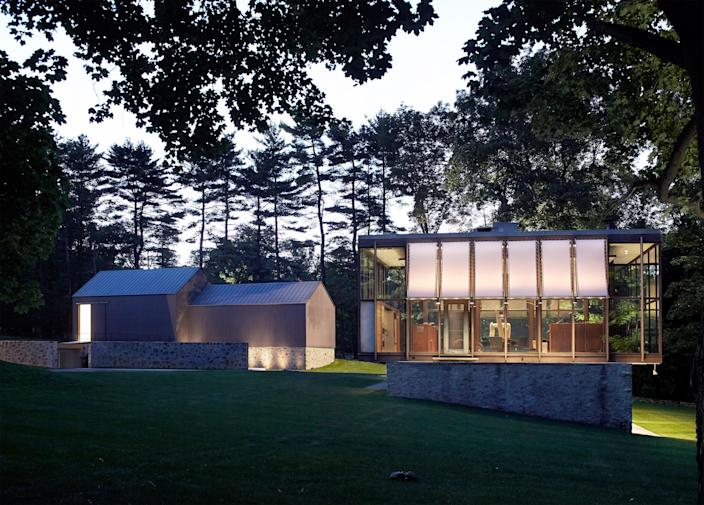 The Wiley House, a double-height glass pavilion set on a fieldstone base, was completed in 1952 by Philip Johnson and renovated in 2008 by Roger Ferris + Partners. The property, which is nestled into a hill and surrounded by hickory trees, features a circular pool resembling the pool at Johnson's Glass House, as well as a new pool house and a reconstructed art barn.