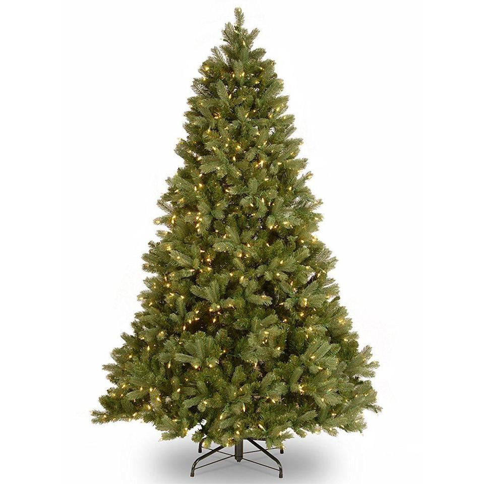 """<p><strong>National Tree Company</strong></p><p>amazon.com</p><p><strong>$329.44</strong></p><p><a href=""""https://www.amazon.com/dp/B008282B68?tag=syn-yahoo-20&ascsubtag=%5Bartid%7C2089.g.334%5Bsrc%7Cyahoo-us"""" rel=""""nofollow noopener"""" target=""""_blank"""" data-ylk=""""slk:Shop Now"""" class=""""link rapid-noclick-resp"""">Shop Now</a></p><p>Dress up your den with this faux fir. Its 1,867 multi-tufted branch tips leave no gaps or spaces in between layers, so it looks even more like the real thing. </p><p>This artificial Christmas tree assembles easily in three sections, and it's pre-strung with 750 incandescent lights. Once it's up, you can skip right to the fun of <a href=""""https://www.bestproducts.com/home/decor/g2045/decorative-christmas-tree-ornaments/"""" rel=""""nofollow noopener"""" target=""""_blank"""" data-ylk=""""slk:hanging ornaments"""" class=""""link rapid-noclick-resp"""">hanging ornaments</a> on it with your family.</p>"""