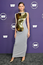 """<p>Zendaya arrived at the 'Women in Film Honors: Trailblazers of the New Normal' event in Los Angeles overnight wearing one helluva dress from Loewe's spring/summer 2022 collection. I mean, check out the trippy gold breastplate situation (!) The whole look was effortlessly tied together with matching drop earrings and a pair of pointed pumps. Honestly, how does she do it?</p><p>Law Roach shared a <a href=""""https://www.instagram.com/p/CUtbm-sJtOt/"""" rel=""""nofollow noopener"""" target=""""_blank"""" data-ylk=""""slk:video"""" class=""""link rapid-noclick-resp"""">video</a> of Zendaya's latest look on Instagram with the caption, """"She was the Queen….. <a href=""""https://www.instagram.com/zendaya/"""" rel=""""nofollow noopener"""" target=""""_blank"""" data-ylk=""""slk:@zendaya"""" class=""""link rapid-noclick-resp"""">@zendaya</a> wearing <a href=""""https://www.instagram.com/loewe/"""" rel=""""nofollow noopener"""" target=""""_blank"""" data-ylk=""""slk:@loewe"""" class=""""link rapid-noclick-resp"""">@loewe</a> SAY SOMETHING???"""" And, like, I couldn't agree more.</p>"""