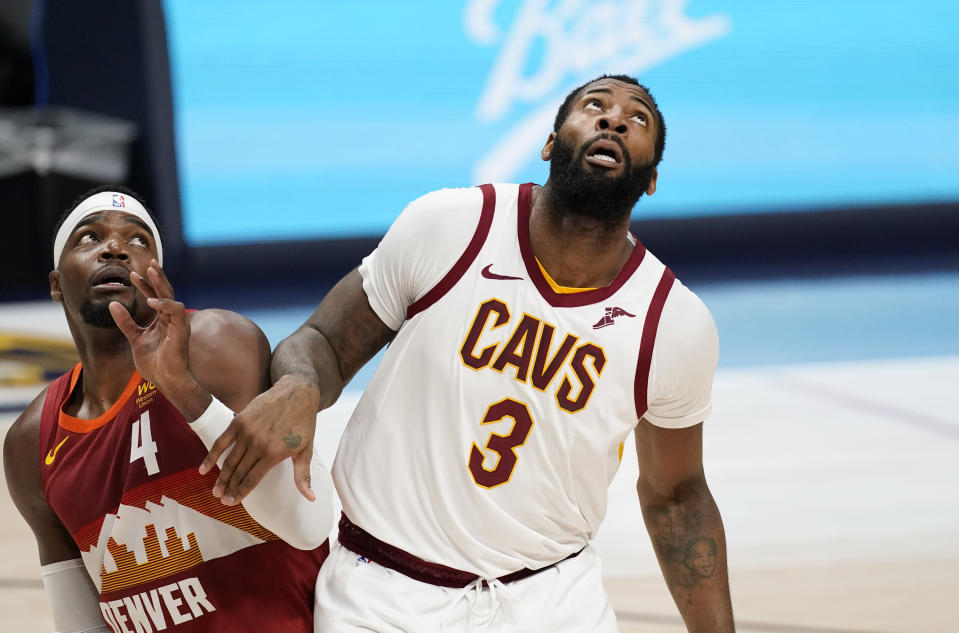 Denver Nuggets forward Paul Millsap, left, fights for position for a rebound with Cleveland Cavaliers center Andre Drummond in the second half of an NBA basketball game Wednesday, Feb. 10, 2021, in Denver. (AP Photo/David Zalubowski)