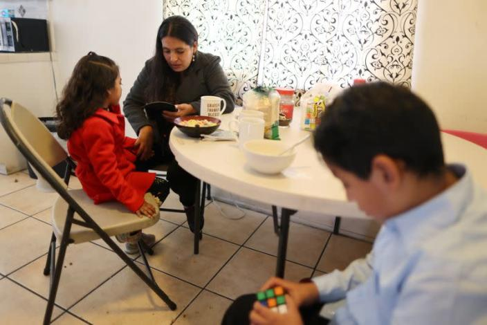 Emiliana, 32, eats breakfast with her son, Leonardo, 10, and daughter, Emily, 5, at their apartment in Los Angeles