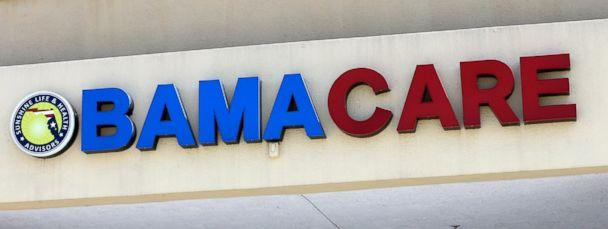 PHOTO: This May 11, 2017, file photo shows an Obamacare sign being displayed on the storefront of an insurance agency in Hialeah, Fla. (AP)